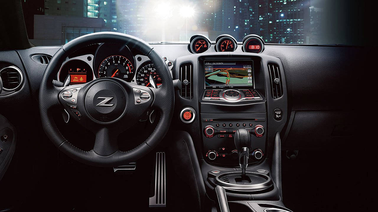 nissan-370z-coupe-interior-black-leather-steering-wheel-large